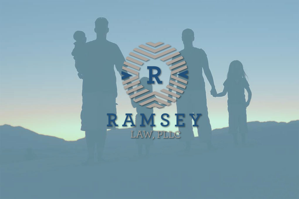 Ramsey Law logo over silhouette of family
