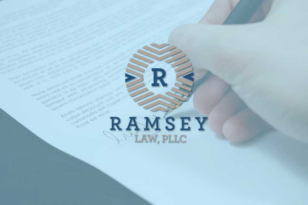 Ramsey Law logo over hand signing legal document
