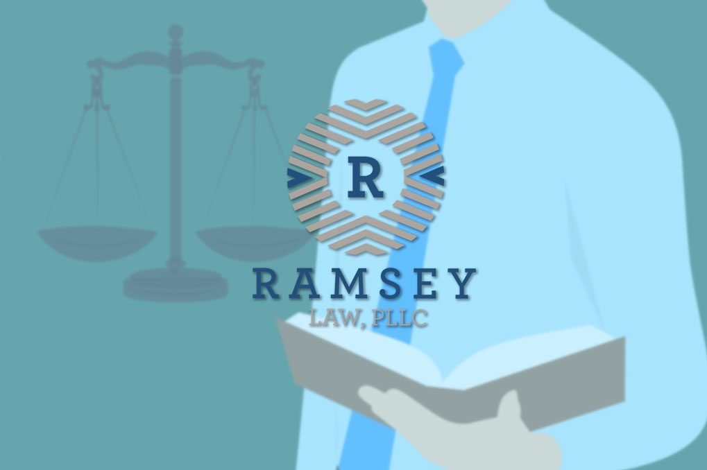 Ramsey Law logo over clip art of man holding book and scales of justice next to him