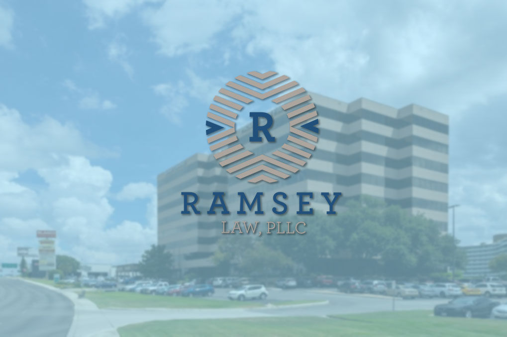 Ramsey Law logo over business building